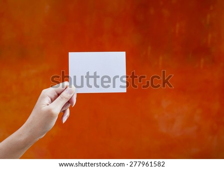 Holding white empty card - stock photo