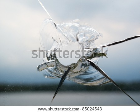 Hole in a broken window - stock photo
