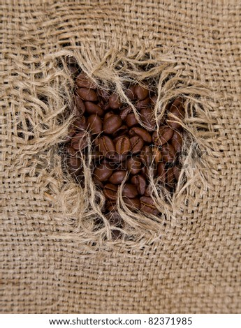 hole in coffee sack - stock photo