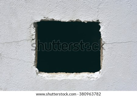 Hole in concrete wall - stock photo