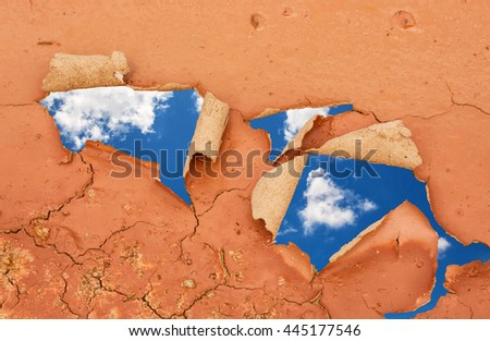 hole in Dry and cracked land, Blue sky - stock photo