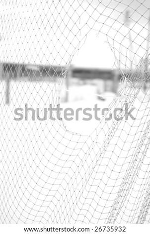 hole in net - stock photo