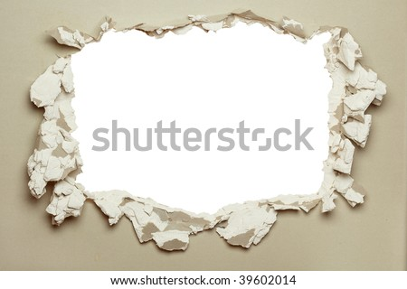 Hole in the grey plasterboard with uneven edges. - stock photo