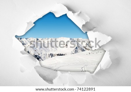 Hole in the paper with torn sides - stock photo