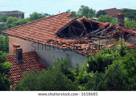 Hole in the roof after earthquake - stock photo
