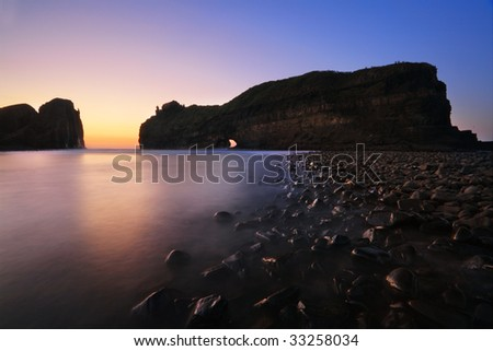 Hole in the wall at sunrise - stock photo