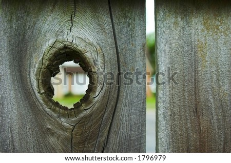 Hole in Wood Fence - stock photo