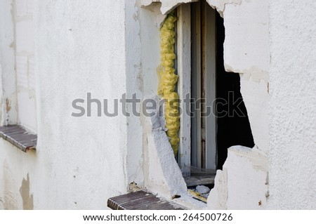 Hole on a broken stone wall - stock photo