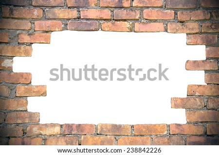 Hole on he brick wall with copyspace area - stock photo