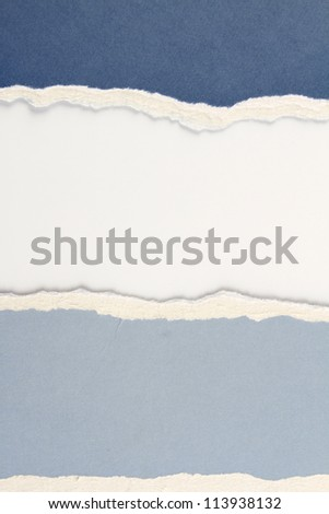 Hole ripped in blue paper on white background. Copy space - stock photo