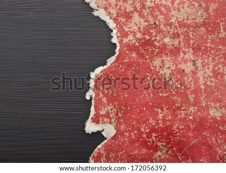 Hole ripped in red paper on black background. Copy space  - stock photo