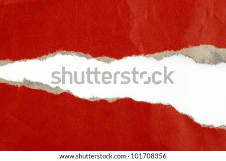 Hole ripped in red paper on plain background - stock photo