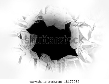hole torn in a piece of metal, with light shining thru - stock photo