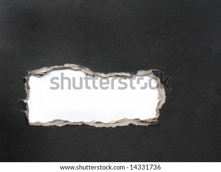 Hole with the fragmentary edges, punched in a cardboard - stock photo