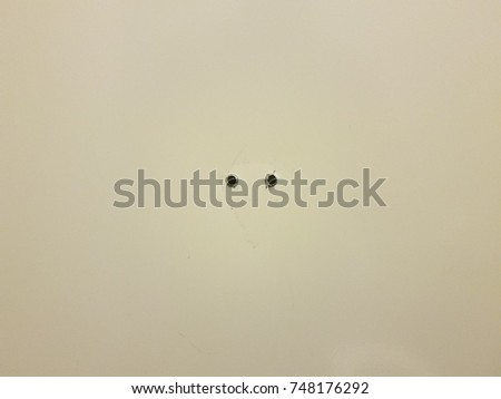 holes in a metal bathroom stall door where a hook was - Bathroom Stall Door