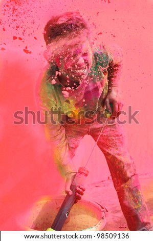Holi celebrations - Boy playing with water colors on Holi in India. - stock photo