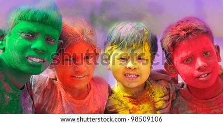 Holi celebrations - Group of kids playing Holi in India. - stock photo