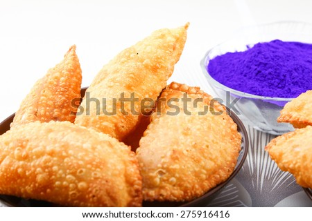 holi color in bowl with gujia - stock photo