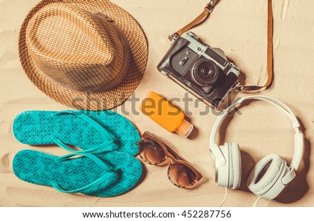 Holiday accessories on sand beach  - stock photo
