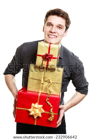 Holiday and special occasion. Young handsome man giving a lot of presents gifts boxes isolated on white. Surprise. Studio shot.