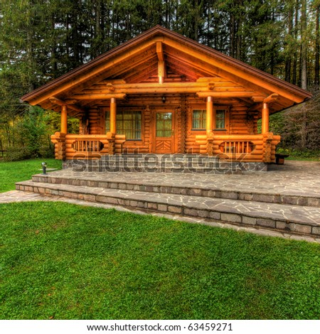 Holiday apartment - wooden cottage in forest - stock photo