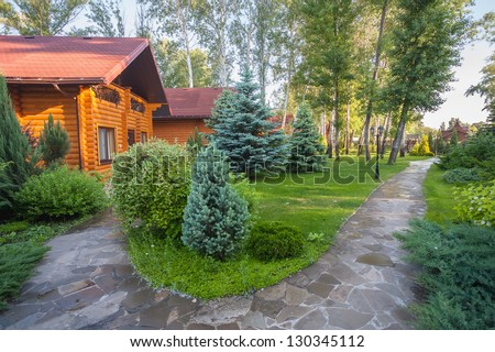 Holiday apartment - wooden cottage in summer forest - stock photo
