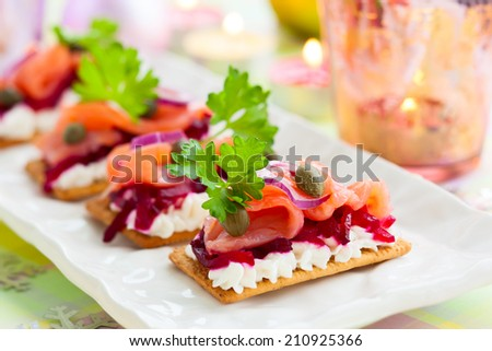 Holiday appetizer with salmon and beetroot - stock photo