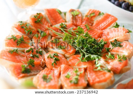 Holiday appetizer with salmon canapes on plate - stock photo