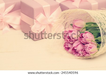 Holiday background with flowers, gift box and silky ribbon - stock photo