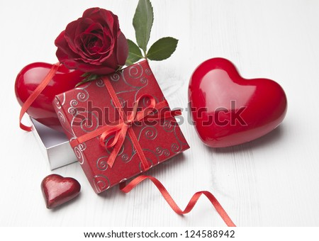 Holiday background with rose petals gift box and red hearts.Valentines day - stock photo