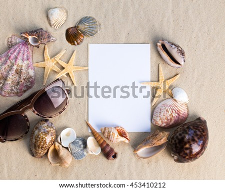 holiday beach concept with shells, seastars and an blank postcard - stock photo