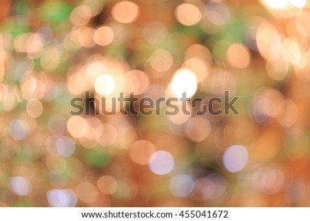 Holiday blurred bokeh background. Christmas background. Horizontal. Warm beige tone with orange and green - stock photo