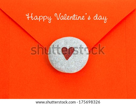 Holiday Card. Heart on stone and paper envelope. Happy Valentines day. - stock photo