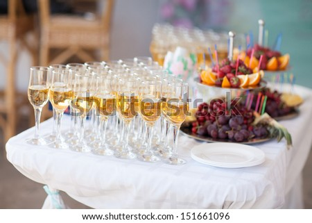 Holiday celebration. Champagne in glasses for wedding party. wedding champagne. wedding party table. wedding table. glasses of champagne - stock photo