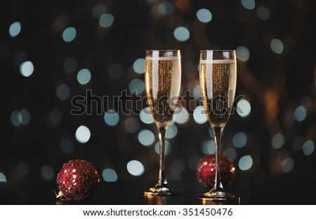 Holiday champagne glasses with New Year decorations
