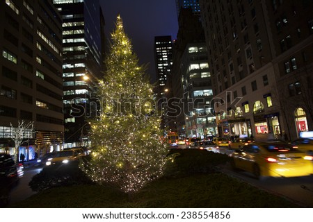 Holiday Christmas tree glowing from the center of Park Avenue in Midtown Manhattan, New York City