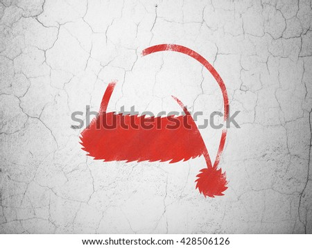 Holiday concept: Red Christmas Hat on textured concrete wall background - stock photo