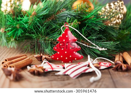 Holiday decorations and winter spices on old rustic wooden background, selective focus. Christmas time - stock photo