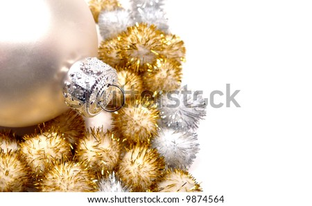Holiday decorations in silver and gold over a white background