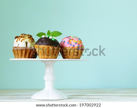 holiday desserts, different decorated cupcakes on the  stand - stock photo