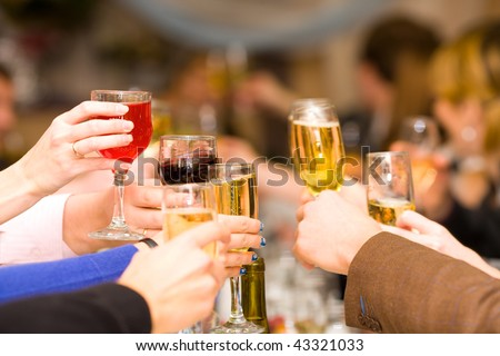 Holiday Event people cheering each other with champagne and wine - stock photo