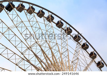 Holiday Ferris Wheel on blue sky background.
