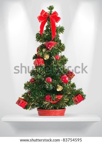 Holiday fir tree on the shelf - stock photo