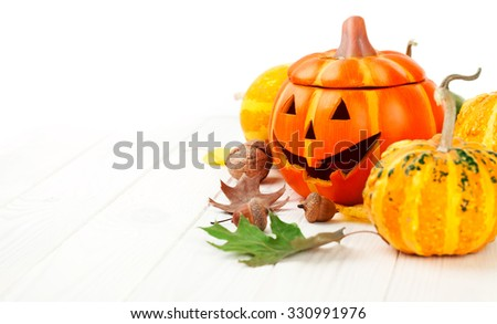 Holiday Halloween autumn decoration with jack-o-lantern pumpkins and yellow leaves. Illustration - stock photo