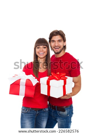holiday happy couple hold present gift box wear red shirt, man and woman love smile embracing, isolated over white background - stock photo