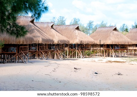 holiday huts on a beach in mozambique - stock photo
