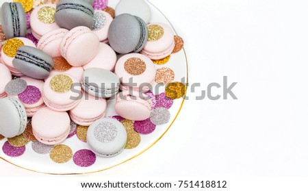 Holiday macaron cookies on a plate.
