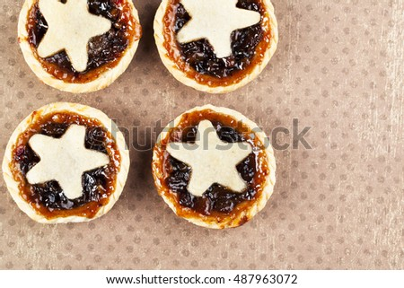 Holiday mince pies with star shape, viewed from above with copy space.