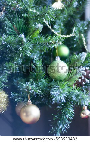 Holiday New Year's decorations on the Christmas tree cones, balls, needles of gold and green