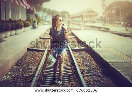 Holiday of travel, Asia woman walking on the railway of train station.